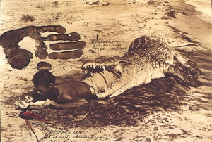 Peter Beard - writing diary in crocodile