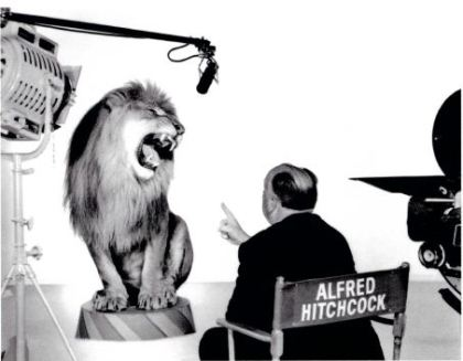 Alfred Hitchcock with the MGM lion, 1958. Photograph by Clarence Sinclair Bull from the John Kobal Foundation Archive.