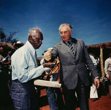 Prime Minister Gough Whitlam pours soil into the hands of traditional land owner Vincent Lingiari, Northern Territory