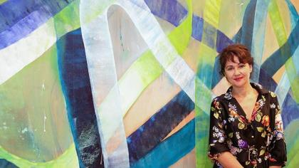 The winner of the Bulgari Art Award, Ildiko Kovacs, with her painting Onda. Photograph by Renee Nowytarger. Image sourced from The Australian.