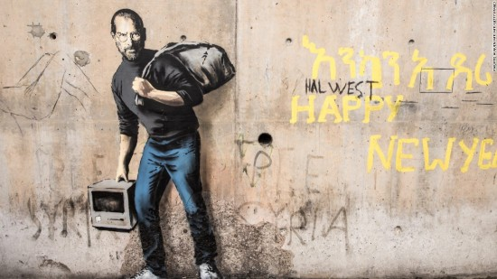 Banksy's recent portrait of Steve Jobs, the son of Syrian immigrants, on the wall at Calais.